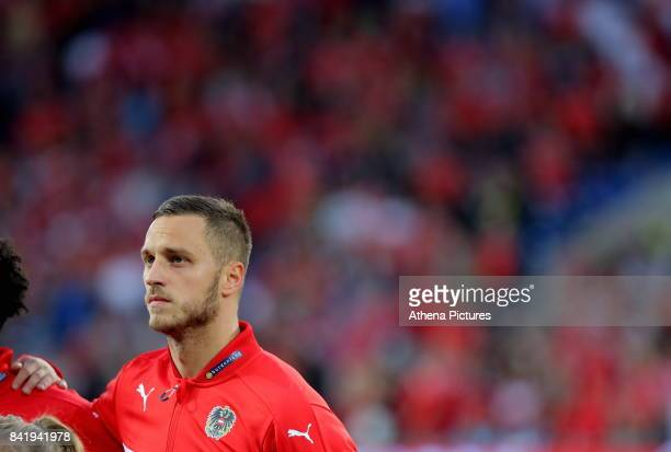 Marco Arnautovic of Austria stands during his country's national anthem during the FIFA World Cup Qualifier Group D match between Wales and Austria...