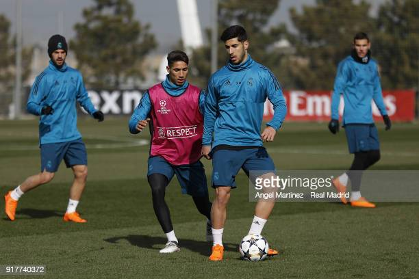 Marco Asensio and Achraf Hakimi of Real Madrid in action during a training session at Valdebebas training ground on February 13 2018 in Madrid Spain