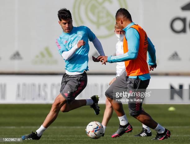 Marco Asensio and Carlos Casemiro both of Real Madrid during a training session at the Valdebebas training ground on February 19, 2021 in Madrid,...