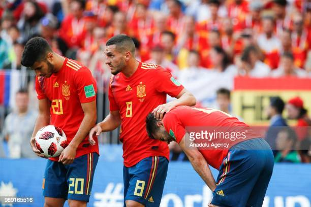 Marco Asensio and Koke of Spain are seen during 2018 FIFA World Cup Russia Round of 16 match between Spain and Russia at the Luzhniki Stadium in...