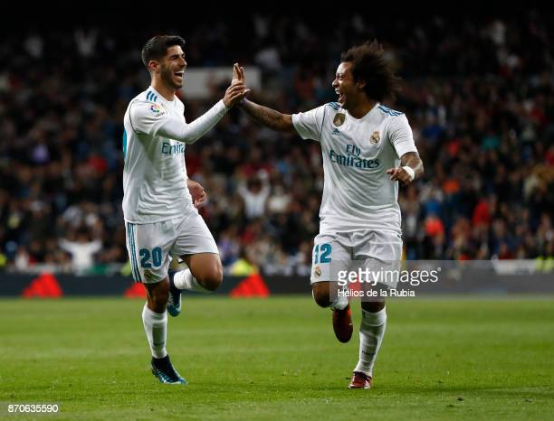 Marco Asensio and Marcelo of Real Madrid celebrate after scoring during the La Liga match between Real Madrid and Las Palmas at Estadio Santiago...