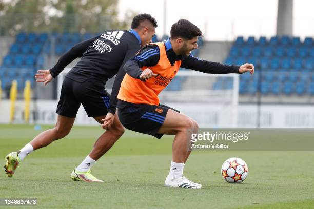 Marco Asensio and Mariano Díaz of Real Madrid are training at Valdebebas training ground on October 16, 2021 in Madrid, Spain.