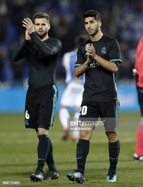 Marco Asensio and Nacho Fernandez of Real Madrid celebrate after the Spanish Copa del Rey Quarter Final First Leg match between Leganes and Real...