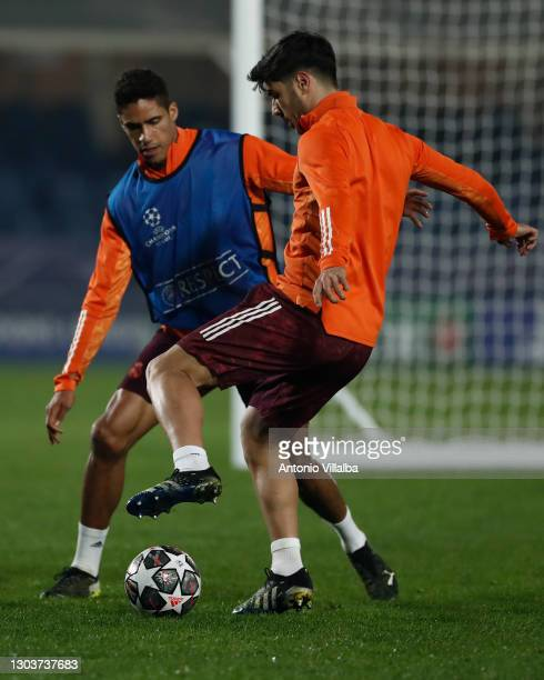 Marco Asensio and Raphael Varane from Real Madrid CF at Valdebebas training ground on February 23, 2021 in Madrid, Spain.