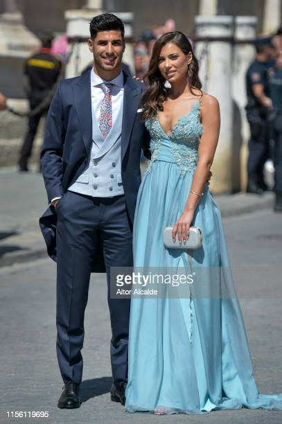 Marco Asensio and Sandra Garal attend the wedding of real Madrid football player Sergio Ramos and Tv presenter Pilar Rubio at Seville's Cathedral on...