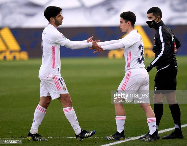 Marco Asensio and Sergio Arribas of Real Madrid salutes during the La Liga Santander match between Real Madrid and Valencia CF at Estadio Alfredo Di...