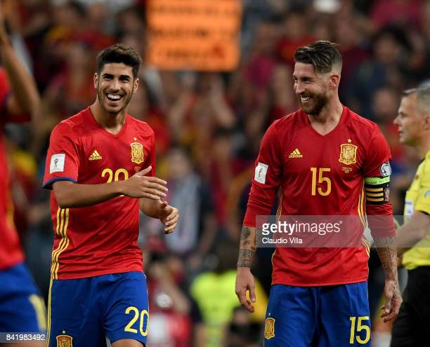 Marco Asensio and Sergio Ramos of Spain celebrate at the end of the FIFA 2018 World Cup Qualifier between Spain and Italy at Estadio Santiago...