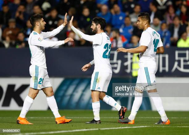 Marco Asensio Casemiro and Isco Alarcon of Real Madrid CF celebrate after scoring during the La Liga match between Malaga and Real Madrid at Estadio...