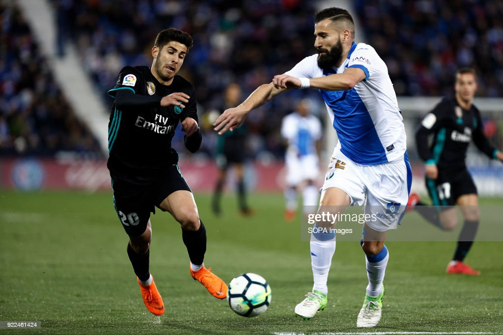 Marco Asensio (Real Madrid) competes for the ball with...