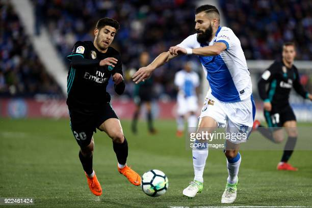 BUTARQUE LEGANES MADRID SPAIN Marco Asensio competes for the ball with Dimitrios Siovas during the La Liga Santander match between Leganes vs Real...