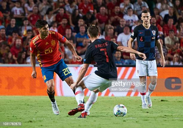 Marco Asensio forward of Spain competes for the ball with Ivan Rakitic midfielder of Croatia during the UEFA Nations League A Group four match...