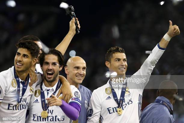 Marco Asensio Isco and Cristiano Ronaldo of Real Madrid during the award ceremony the UEFA Champions League Final between Juventus and Real Madrid at...