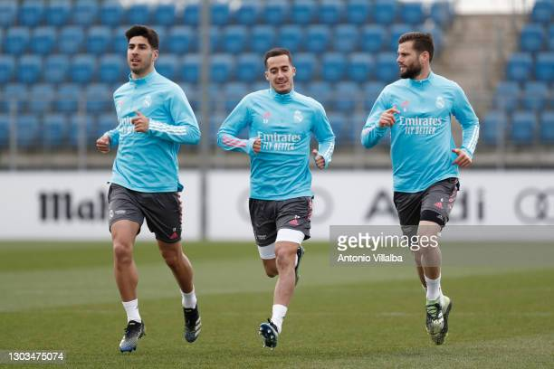 Marco Asensio, Nacho Fernández and Lucas Vázquez from Real Madrid at Valdebebas training ground on February 22, 2021 in Madrid, Spain.