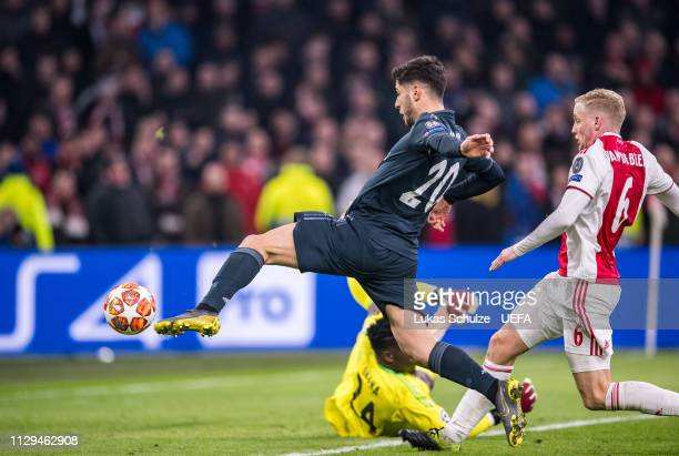 Marco Asensio of Madrid scores his team's second goal during the UEFA Champions League Round of 16 First Leg match between Ajax and Real Madrid at...