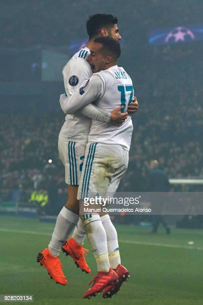 Marco Asensio of Real Madrid and Lucas Vazquez of Real Madrid celebrate the first goal of their team during the UEFA Champions League Round of 16...