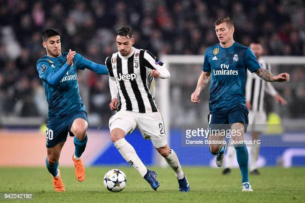 Marco Asensio of Real Madrid and Mattia De Sciglio of Juventus in action during the UEFA Champions League Quarter Final Leg One match between...