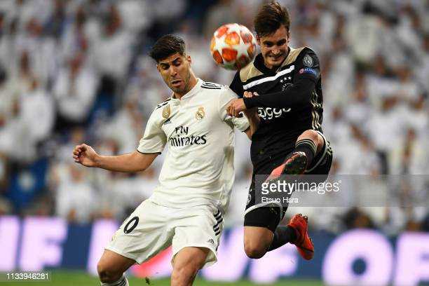 Marco Asensio of Real Madrid and Nicolas Tagliafico of Ajax compete for the ball during the UEFA Champions League Round of 16 Second Leg match...
