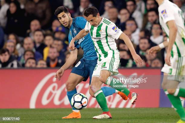 Marco Asensio of Real Madrid Andres Guardado of Real Betis during the La Liga Santander match between Real Betis Sevilla v Real Madrid at the Estadio...