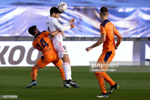 Marco Asensio of Real Madrid battle for the ball with Jose Gaya of Valencia during the La Liga Santander match between Real Madrid and Valencia CF at...