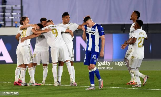Marco Asensio of Real Madrid celebrate with his team mates after he scores his team's 2nd goal during the Liga match between Real Madrid CF and...