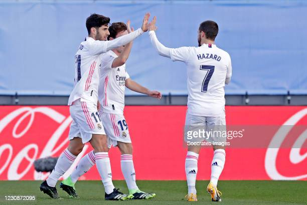 Marco Asensio of Real Madrid celebrates 1-0 with Alvaro Odriozola of Real Madrid, Eden Hazard of Real Madrid during the La Liga Santander match...