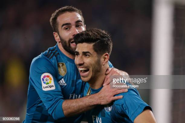 Marco Asensio of Real Madrid celebrates 23 with Daniel Carvajal of Real Madrid during the La Liga Santander match between Real Betis Sevilla v Real...