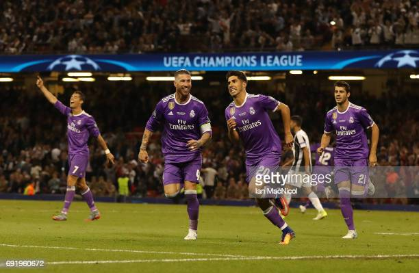 Marco Asensio of Real Madrid celebrates after he scores his team's fourth goal during the UEFA Champions League Final between Juventus and Real...