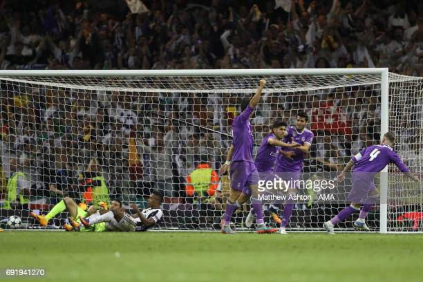Marco Asensio of Real Madrid celebrates after scoring a goal to make it 1-4 during the UEFA Champions League Final between Juventus and Real Madrid...