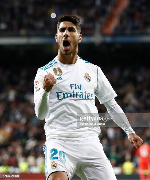 Marco Asensio of Real Madrid celebrates after scoring during the La Liga match between Real Madrid and Las Palmas at Estadio Santiago Bernabeu on...