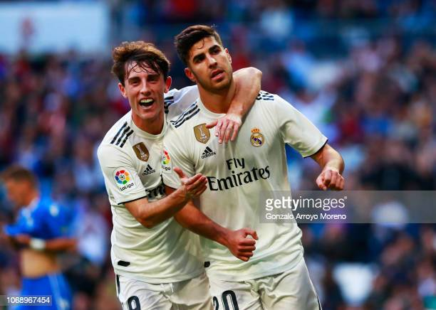 Marco Asensio of Real Madrid celebrates after scoring his team's first goal with Alvaro Odriozola during the Copa del Rey fourth round match between...