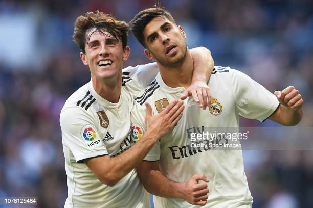 Marco Asensio of Real Madrid celebrates after scoring his team's first goal with Alvaro Odriozola during the Spanish Copa del Rey second leg match...