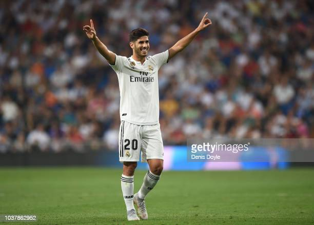 Marco Asensio of Real Madrid celebrates after scoring his teams opening goal during the La Liga match between Real Madrid CF and RCD Espanyol at...