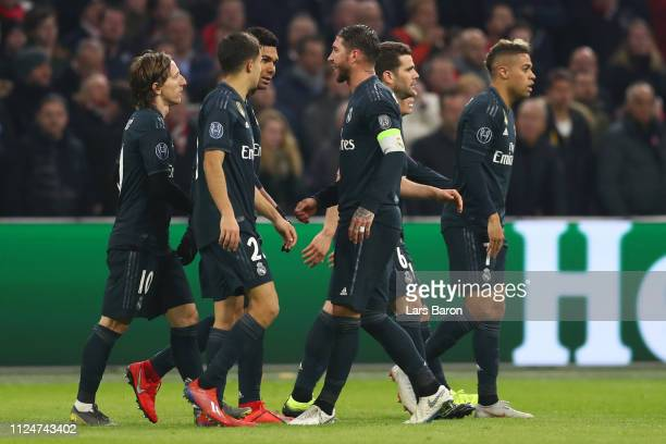 Marco Asensio of Real Madrid celebrates after scoring his team's second goal with his team mates during the UEFA Champions League Round of 16 First...