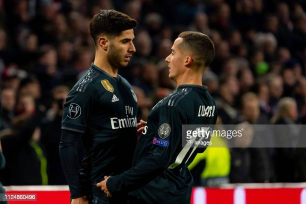Marco Asensio of Real Madrid celebrates after scoring his team's second goal during the UEFA Champions League Round of 16 First Leg match between...