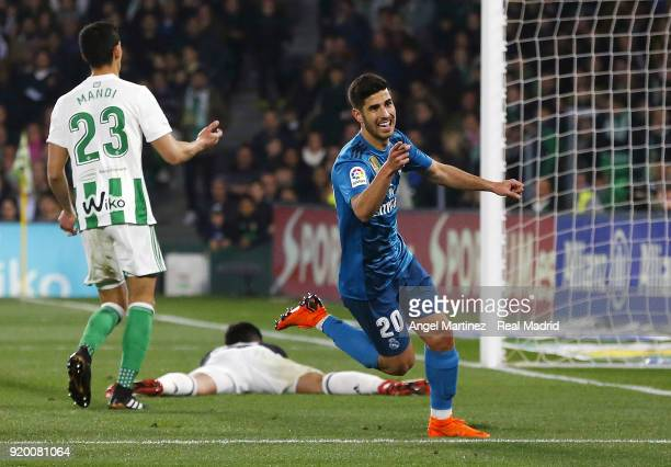 Marco Asensio of Real Madrid celebrates after scoring his team's third goal during the La Liga match between Real Betis and Real Madrid at Estadio...