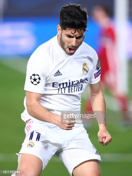 Marco Asensio of Real Madrid celebrates after scoring their team's second goal during the UEFA Champions League Quarter Final match between Real...