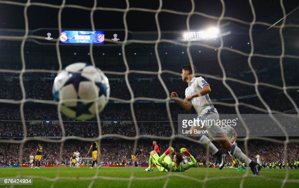 Marco Asensio of Real Madrid celebrates as Cristiano Ronaldo of Real Madrid scores their second goal during the UEFA Champions League semi final...