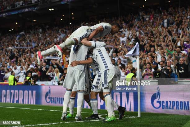 Marco Asensio of Real Madrid celebrates scoring his sides fourth goal with his Real Madrid team mates during the UEFA Champions League Quarter Final...