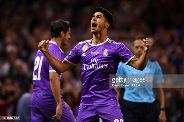 Marco Asensio of Real Madrid celebrates scoring his sides fourth goal during the UEFA Champions League Final between Juventus and Real Madrid at...