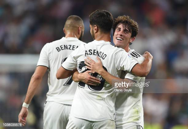 Marco Asensio of Real Madrid celebrates with Alvaro Odriozola after scoring his teams opening goal during the La Liga match between Real Madrid CF...
