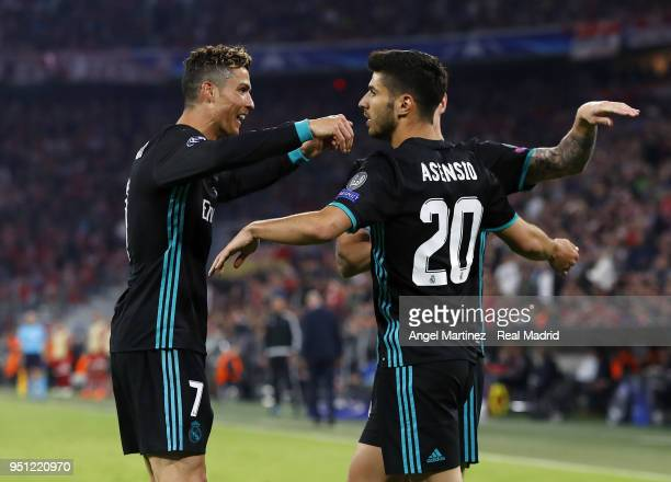 Marco Asensio of Real Madrid celebrates with Cristiano Ronaldo after scoring their team's second goal during the UEFA Champions League Semi Final...