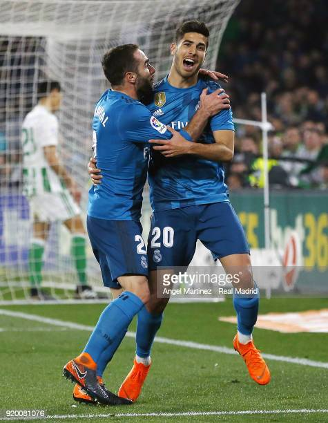Marco Asensio of Real Madrid celebrates with Daniel Carvajal after scoring their team's third goal during the La Liga match between Real Betis and...