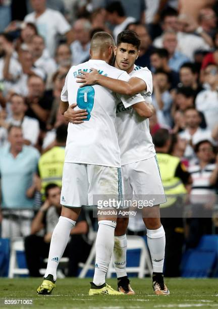 Marco Asensio of Real Madrid celebrates with his teammate Karim Benzema after scoring during the La Liga soccer match between Real Madrid and...