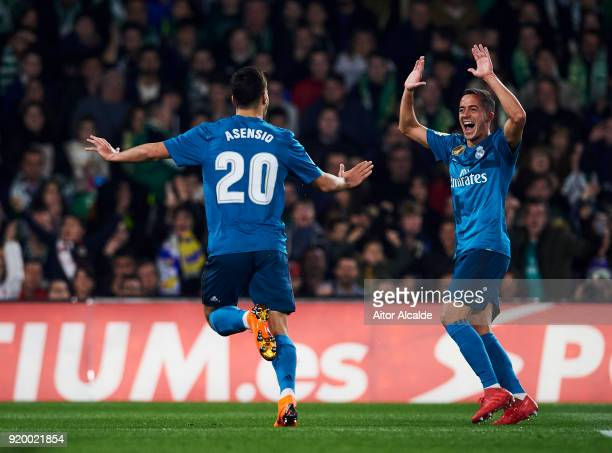 Marco Asensio of Real Madrid celebrates with his teammate Lucas Vazquez of Real Madrid after scoring the opening goal during the La Liga match...