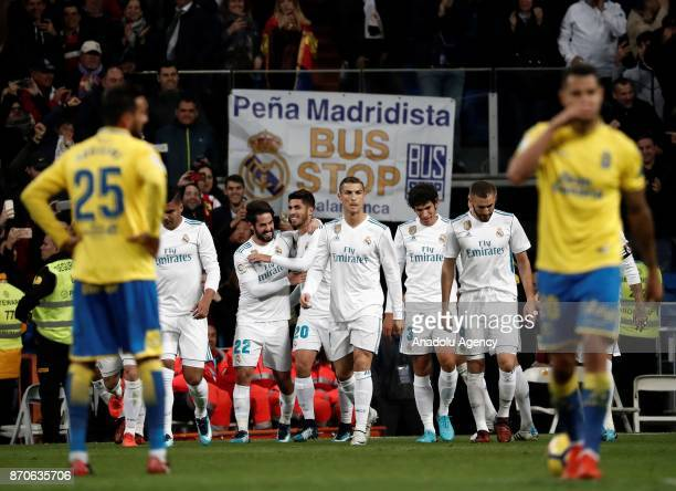 Marco Asensio of Real Madrid celebrates with his teammates after a scoring a goal during the Spanish La Liga football match between Real Madrid and...