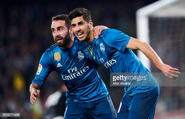 Marco Asensio of Real Madrid celebrates with his teammates Daniel Carvajal of Real Madrid after scoring his team's third goal during the La Liga...