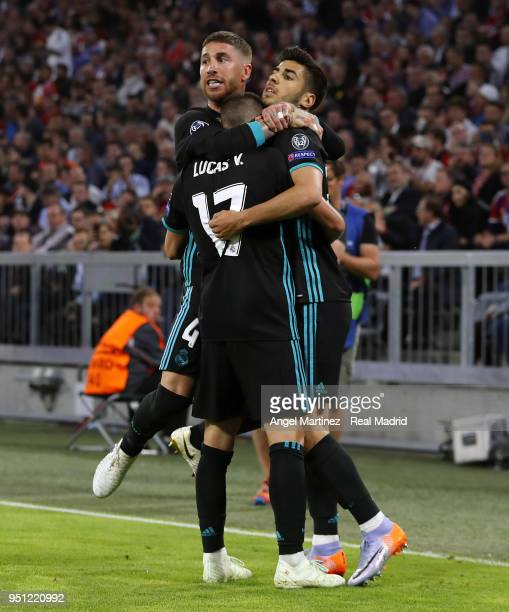 Marco Asensio of Real Madrid celebrates with Lucas Vazquez and Sergio Ramos after scoring their team's second goal during the UEFA Champions League...