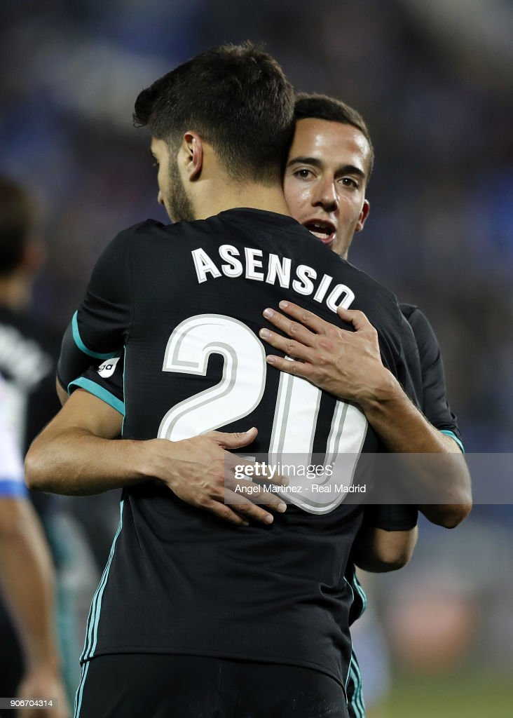 Marco Asensio (L) of Real Madrid celebrates with Lucas Vazquez scoring the opening goal during the Spanish Copa del Rey, Quarter Final, First Leg match between Leganes and Real Madrid at Estadio Municipal de Butarque on January 18, 2018 in Leganes, Spain.