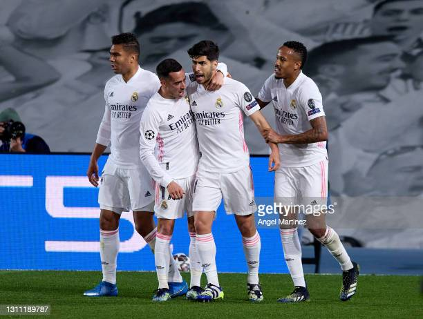 Marco Asensio of Real Madrid celebrates with team mates after scoring their team's second goal during the UEFA Champions League Quarter Final match...