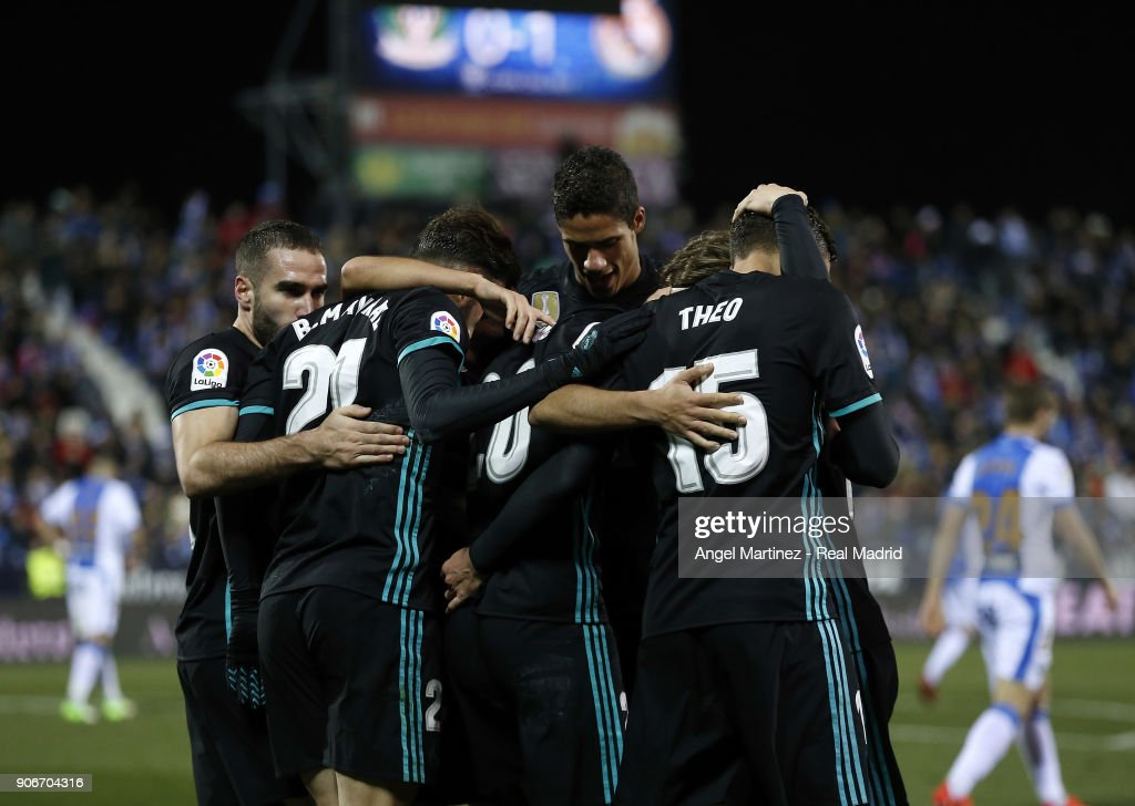 Marco Asensio (C) of Real Madrid celebrates with team mates after scoring the opening goal during the Spanish Copa del Rey, Quarter Final, First Leg match between Leganes and Real Madrid at Estadio Municipal de Butarque on January 18, 2018 in Leganes, Spain.